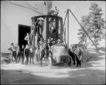 A crowd surrounding the lower section of the 100-inch telescope tube, Mount Wilson Observatory.