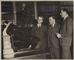 Walter S. Adams, James H. Jeans and Edwin Powell Hubble at a model of the 100-inch telescope in...