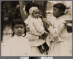 Four Chinese children in western...