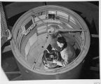 Bill Baum loading the plateholder inside the 200-inch telescope prime focus cage, Palomar...