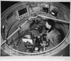 Bill Baum with stellar photometer inside the 200-inch telescope prime focus cage, Palomar...