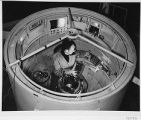 Bill Baum changing plateholders inside the 200-inch telescope prime focus cage, Palomar...