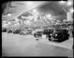 REO automobiles at an auto show. 1934.