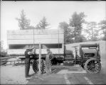 Two men with loaded 3-ton truck, Mount Wilson Observatory.