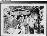 Harry Chandler with a group of people at Acorn Lodge.