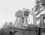 Astronomer with 100-inch focal length aerial camera, on Mount Wilson.