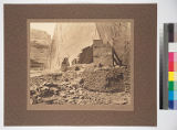A canyon prehistoric building partly destroyed by falling rock from cliff wall. Del Muerto,...