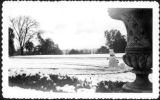 Snowman and east lawn after snowfall, February 1948.