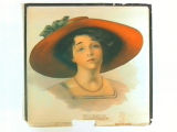 Stock label: woman wearing red sun hat with green bow, pink dress and necklace.