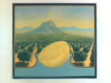 Stock label: grapefruit half with orchard and mountain.