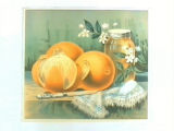 Stock label: oranges, blossoms, knife, and jar of preserves on towel.