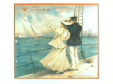 Stock label: man and woman on ship deck watching sailboats.