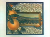 Stock label: oranges with framed picture of orchard and mountains on paisley wall.